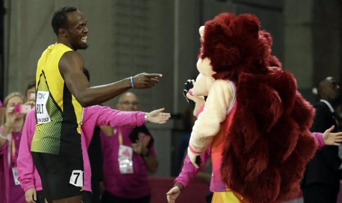 Bolt celebra tras conseguir la victoria en primera ronda /Foto AP