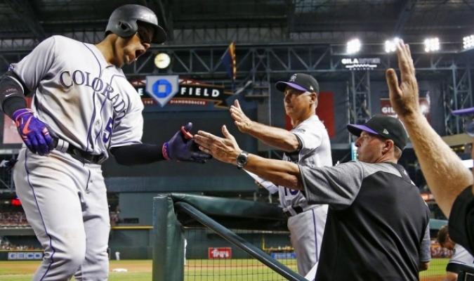 Carlos González recibió elogios de su mánager /Foto AP