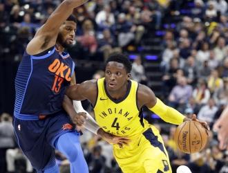 Paul George y Victor Oladipo / AP