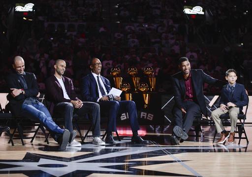 Duncan junto sus hijos /Foto AP