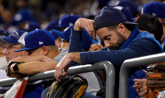 Los aficionados llenos de tristeza / AP